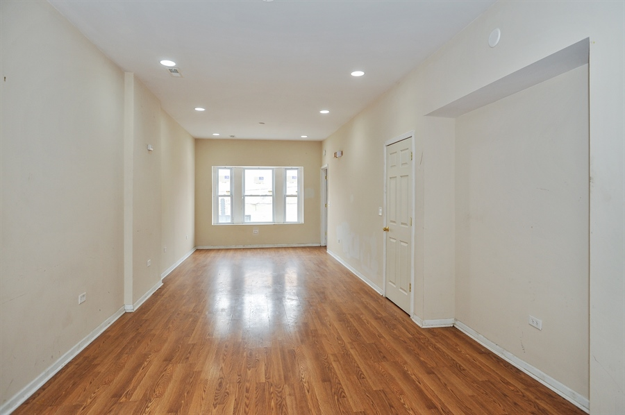 Real Estate Photography - 5301 West Chicago Ave, Chicago, IL, 60651 - Apartment 1 living room/dining room combo