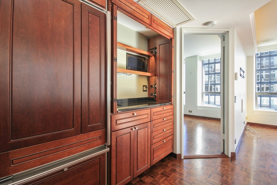 Real Estate Photography - 260 E. Chestnut Street, Unit 1412, Chicago, IL, 60611 - Built in Cabinets with Refridgerator