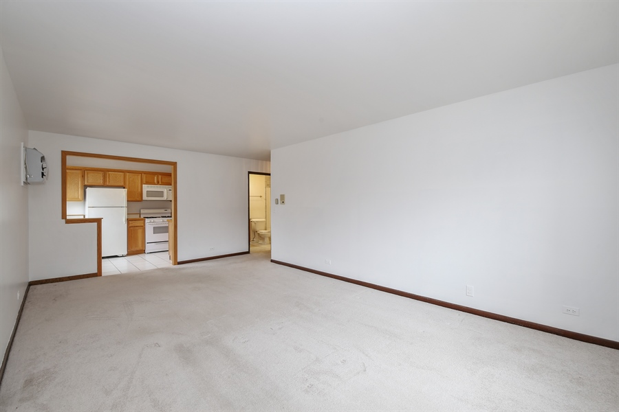 Real Estate Photography - 1258 Brown Street, Unit 102, Des Plaines, IL, 60016 - Kitchen / Living Room