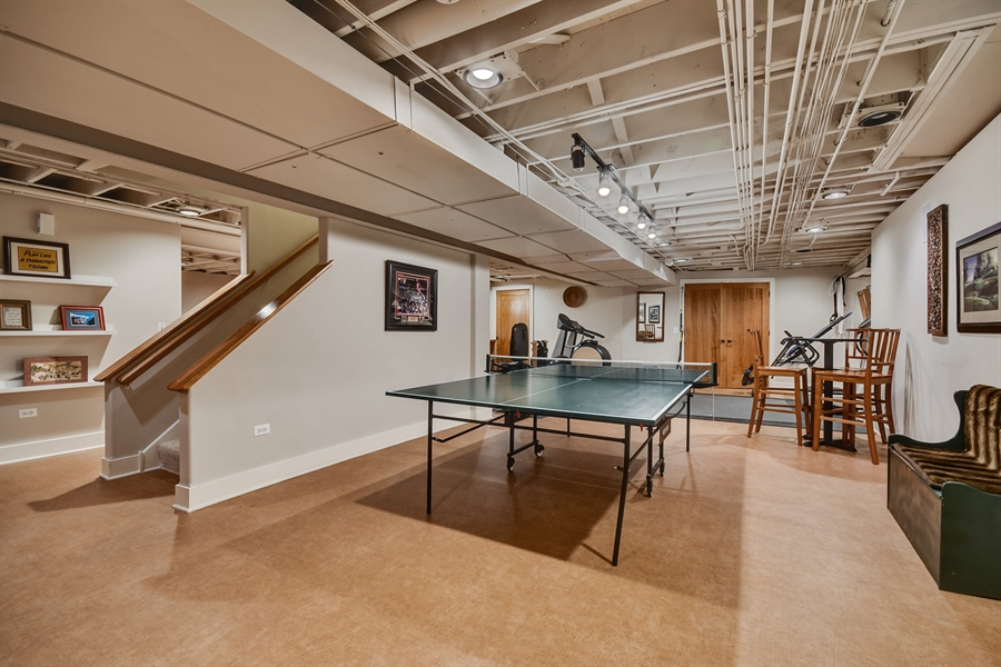 """Real Estate Photography - 1221 Millet Street, Naperville, IL, 60563 - Versatile finished basement has a relaxed """"loft fe"""