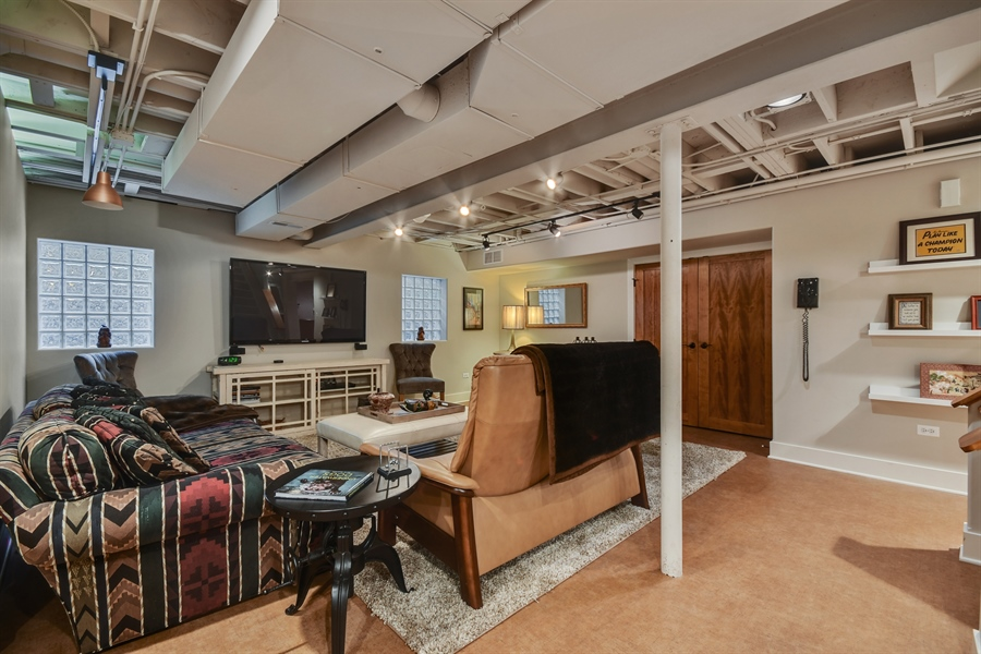 Real Estate Photography - 1221 Millet Street, Naperville, IL, 60563 - TV/Media area in the finished basement