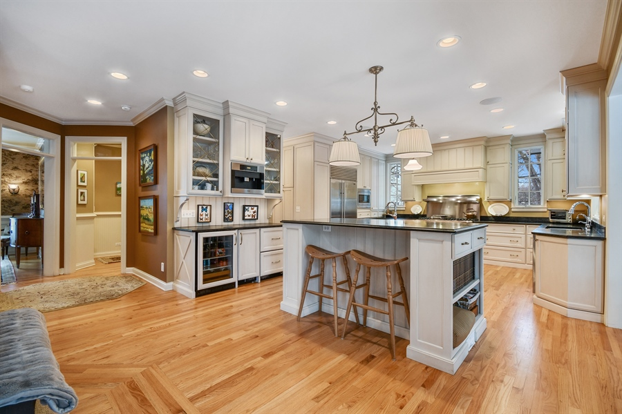Real Estate Photography - 1221 Millet Street, Naperville, IL, 60563 - Twin islands help make this THE gathering place!