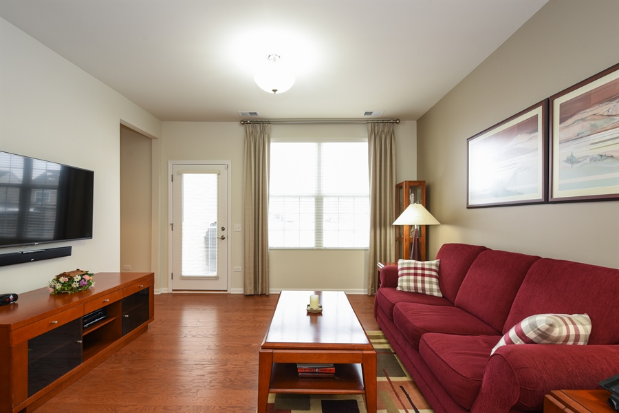 Real Estate Photography - 811 Rocky Gap Drive, Elgin, IL, 60124 - LIVING ROOM WITH HARDWOOD FLOORING
