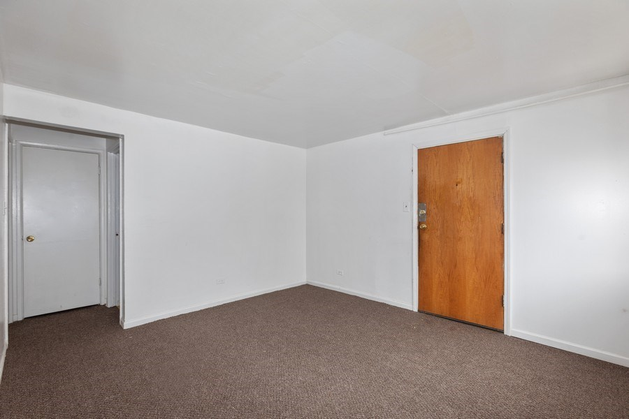 Real Estate Photography - 1436 East 73Rd St, Chicago, IL, 60619 - Living Room