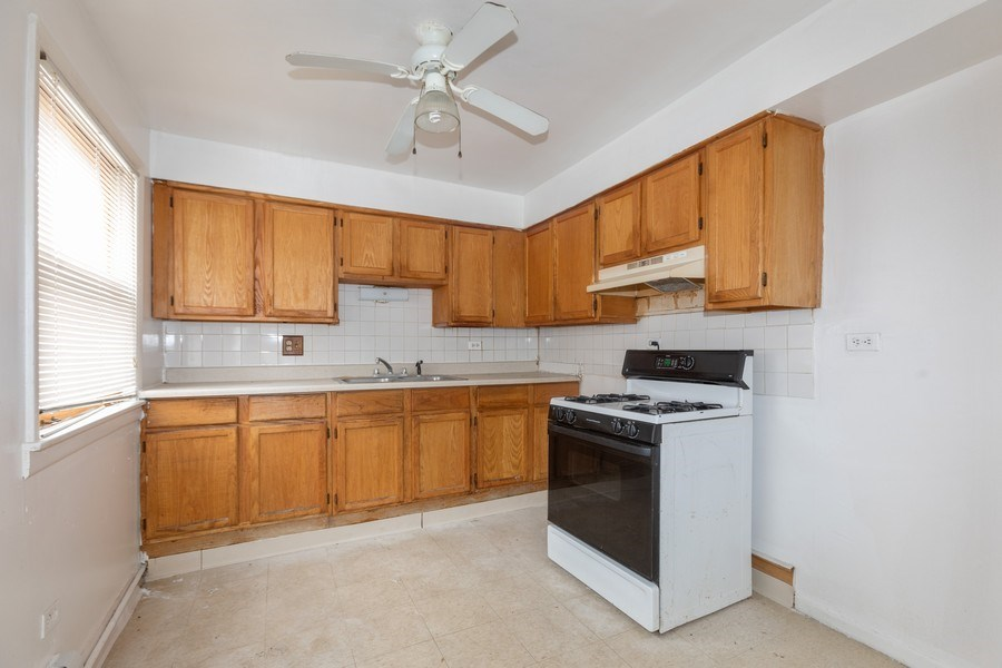 Real Estate Photography - 1436 East 73Rd St, Chicago, IL, 60619 - Kitchen