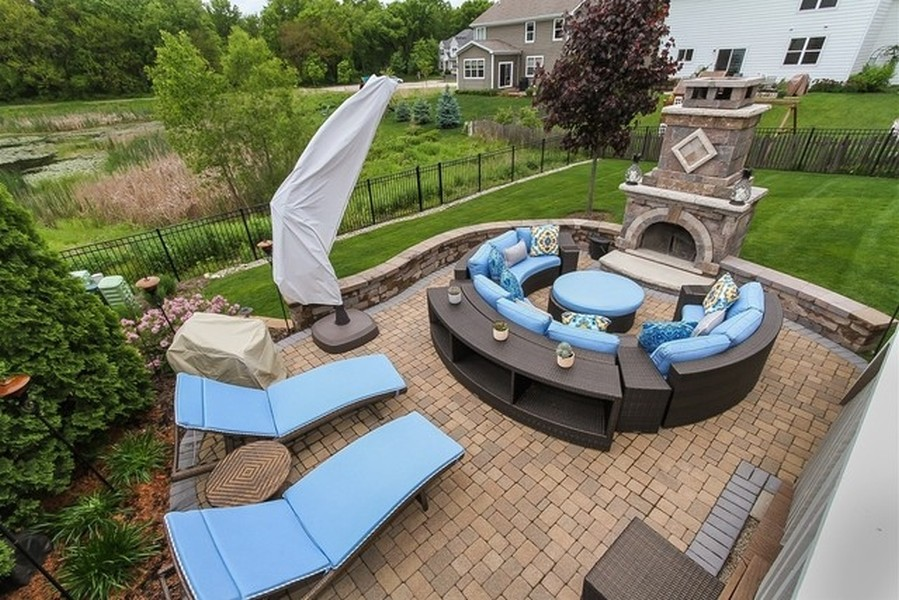 Real Estate Photography - 758 Goodfield Landing, Elgin, IL, 60124 - Summer View of Patio, Fireplace & Wooded backdrop