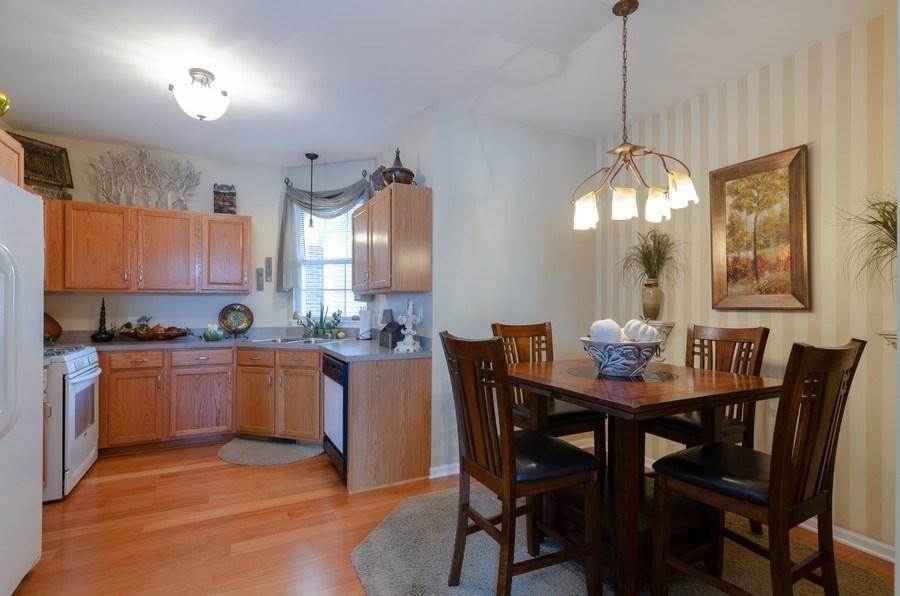 Real Estate Photography - 7321 Grandview Court, Unit 7321, Carpentersville, IL, 60110 - Kitchen / Dining Room