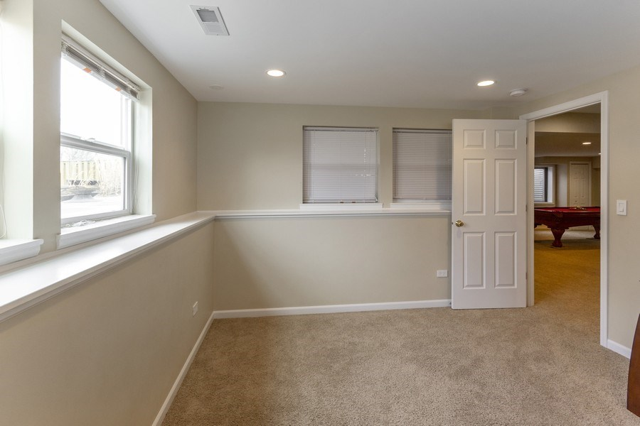 Real Estate Photography - 2400 Mckenzie Court, Aurora, IL, 60503 - Extra Room in the Basement - Perfect Office Space