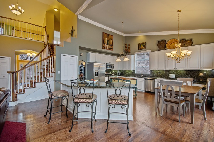 Real Estate Photography - 1508 Cocalico Court, Naperville, IL, 60563 - Enjoy a snack or conversation at the island