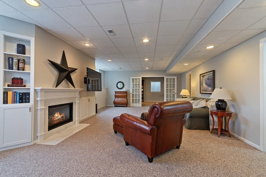 Real Estate Photography - 1508 Cocalico Court, Naperville, IL, 60563 - Added dimension to basement relaxation