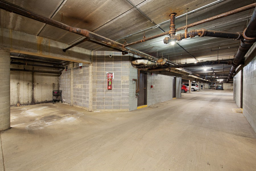 Real Estate Photography - 2201 S. Grace Street, Unit 507, Lombard, IL, 60148 - Underground Heated Garage