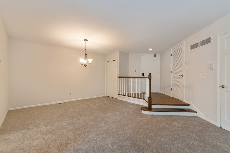 Real Estate Photography - 115 Dunham Place Commons, Unit 115, St. Charles, IL, 60174 - Dining Room