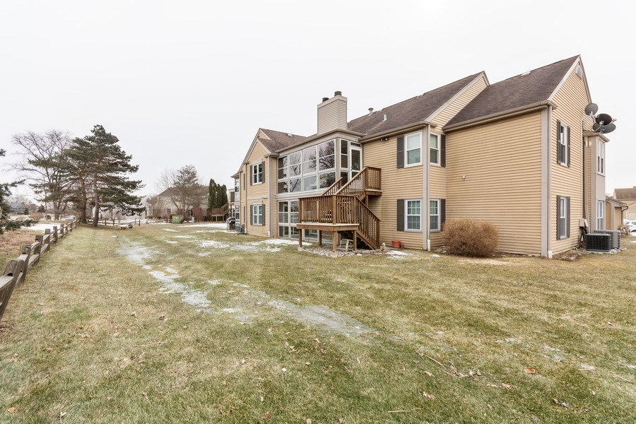 Real Estate Photography - 115 Dunham Place Commons, Unit 115, St. Charles, IL, 60174 - Back Yard