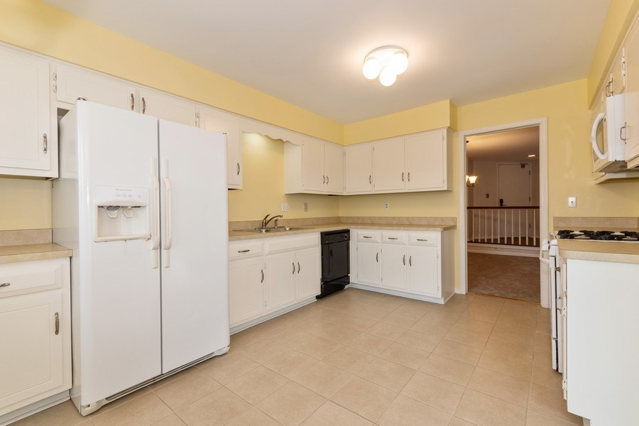 Real Estate Photography - 115 Dunham Place Commons, Unit 115, St. Charles, IL, 60174 - Kitchen