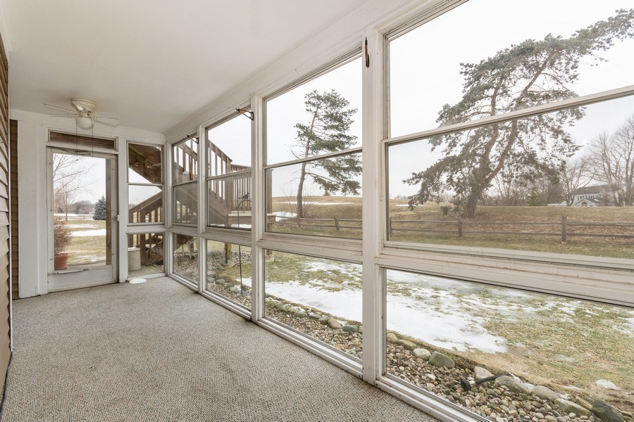 Real Estate Photography - 115 Dunham Place Commons, Unit 115, St. Charles, IL, 60174 - Sun Room