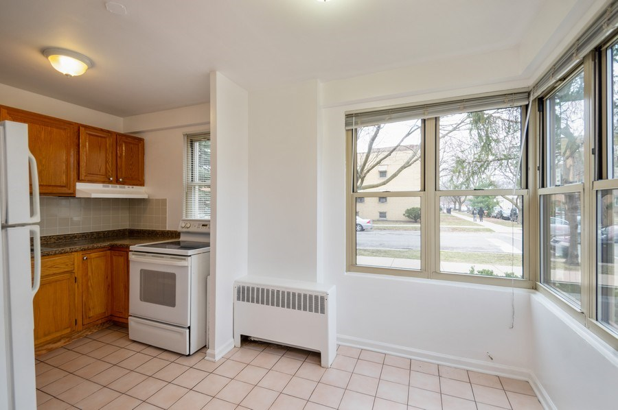Real Estate Photography - 2606 W. BALMORAL Avenue, Unit 108, Chicago, IL, 60625 - Kitchen / Dining Room