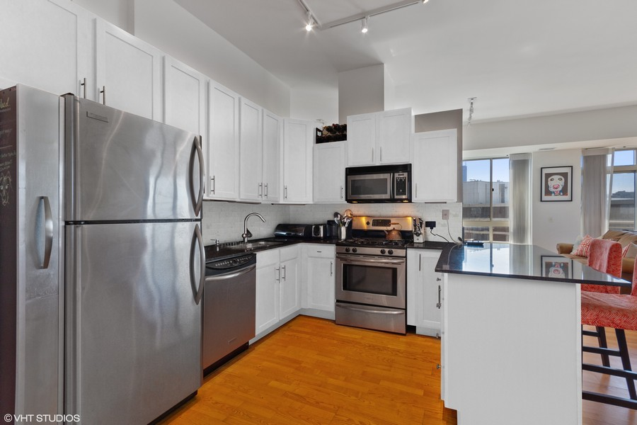 Real Estate Photography - 230 W. Division Street, Unit 801, Chicago, IL, 60610 - Kitchen with virtually painted cabinets & backspla