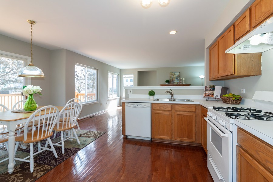 Real Estate Photography - 146 Cider Street, Bolingbrook, IL, 60490 - Family Room / Kitchen