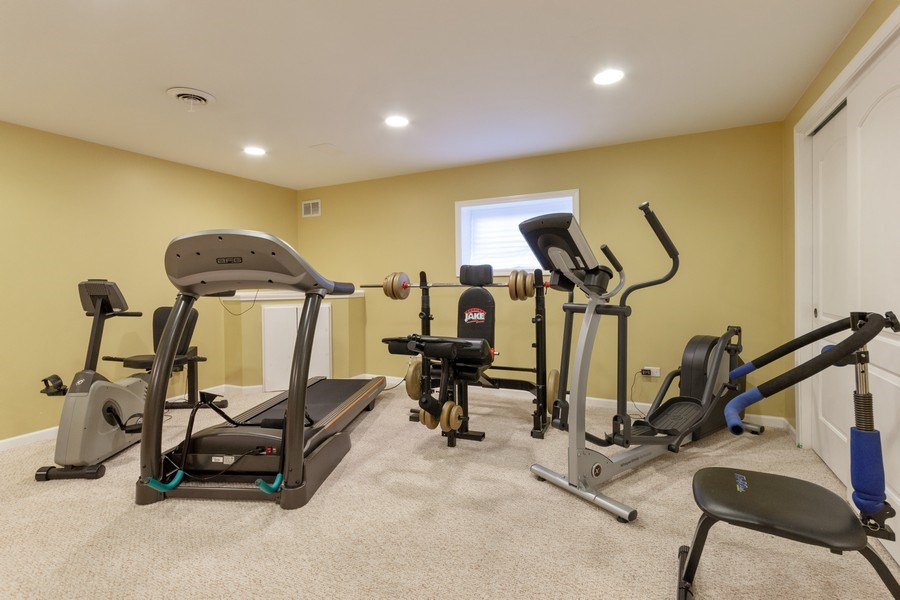 Real Estate Photography - 13602 Rockefeller Circle, Plainfield, IL, 60544 - Basement Exercise Area