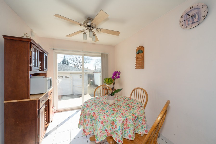 Real Estate Photography - 5037 HAROLD Avenue, Schiller Park, IL, 60176 - Eat In Kitchen Area