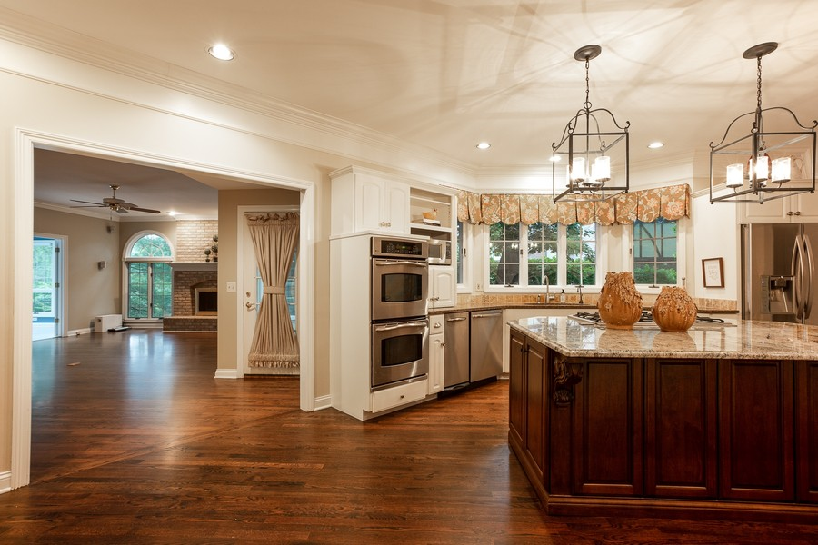 Real Estate Photography - 107 BRIDGEWATER Court, Naperville, IL, 60565 - KITCHEN OPEN TO FAMILY ROOM