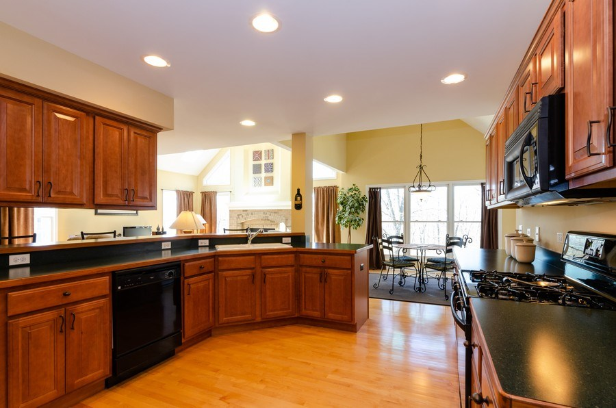 Real Estate Photography - 904 Tipperary Street, Gilberts, IL, 60136 - Kitchen has breakfast bar & Table