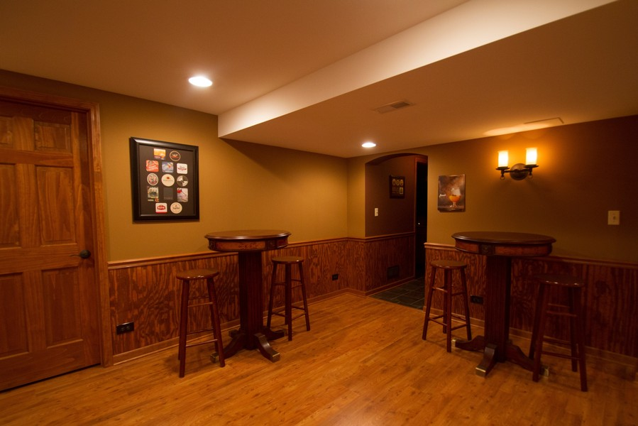 Real Estate Photography - 904 Tipperary Street, Gilberts, IL, 60136 - Pub tables