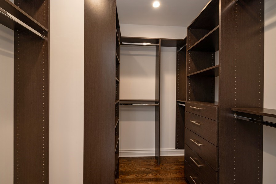 Real Estate Photography - 4130 North Mango Ave, Chicago, IL, 60634 - Master Bedroom Closet