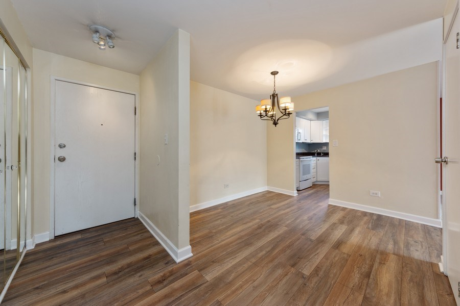 Real Estate Photography - 960 S. River Road, Unit 102, Des Plaines, IL, 60016 - Foyer/Dining Room