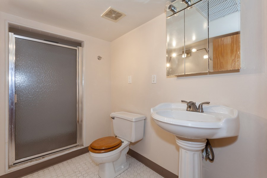 Real Estate Photography - 1309 Ridgeland Ave, Berwyn, IL, 60402 - Basement half bath