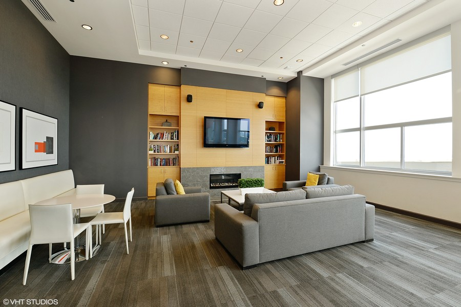 Real Estate Photography - 1901 S. Calumet Avenue, Unit 1407, Chicago, IL, 60616 - Social Room with Fireplaces & TV's