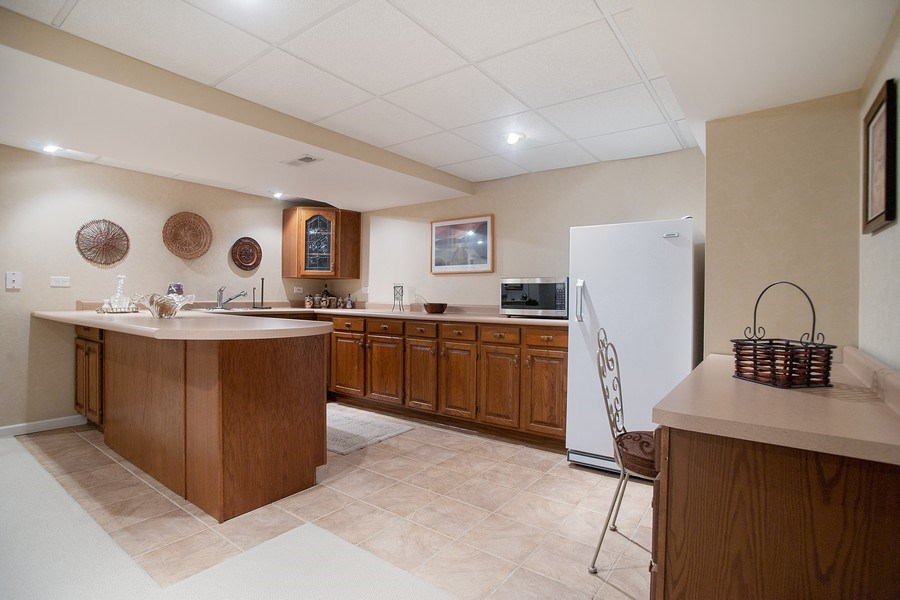 Real Estate Photography - 108 Andover Drive, Prospect Heights, IL, 60070 - Basement Wet Bar/Entertaining Area