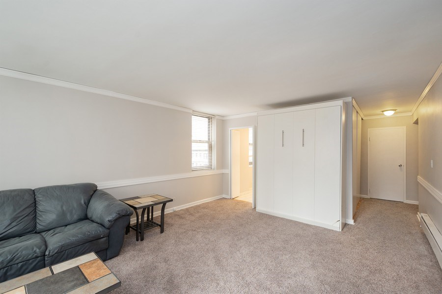 Real Estate Photography - 253 E. Delaware Place, Unit 8H, Chicago, IL, 60611 - Northwest View of Living/Dining/Sleeping Room