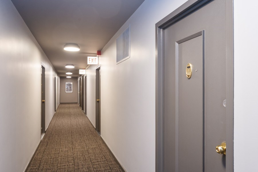 Real Estate Photography - 253 E. Delaware Place, Unit 8H, Chicago, IL, 60611 - 8th Floor Remodeled Hallway & Upgraded Elevators