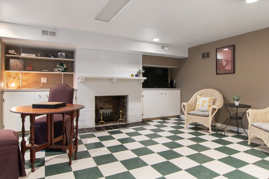 Real Estate Photography - 3206 Park Place, Evanston, IL, 60201 - Basement Rec. Room w/ Decorative Fireplace