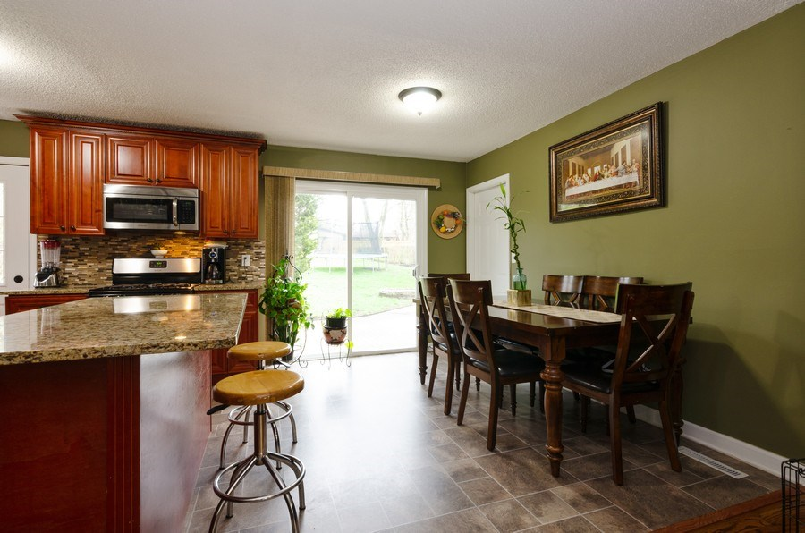 Real Estate Photography - 105 WOODCREST Circle, Streamwood, IL, 60107 - Dining Room
