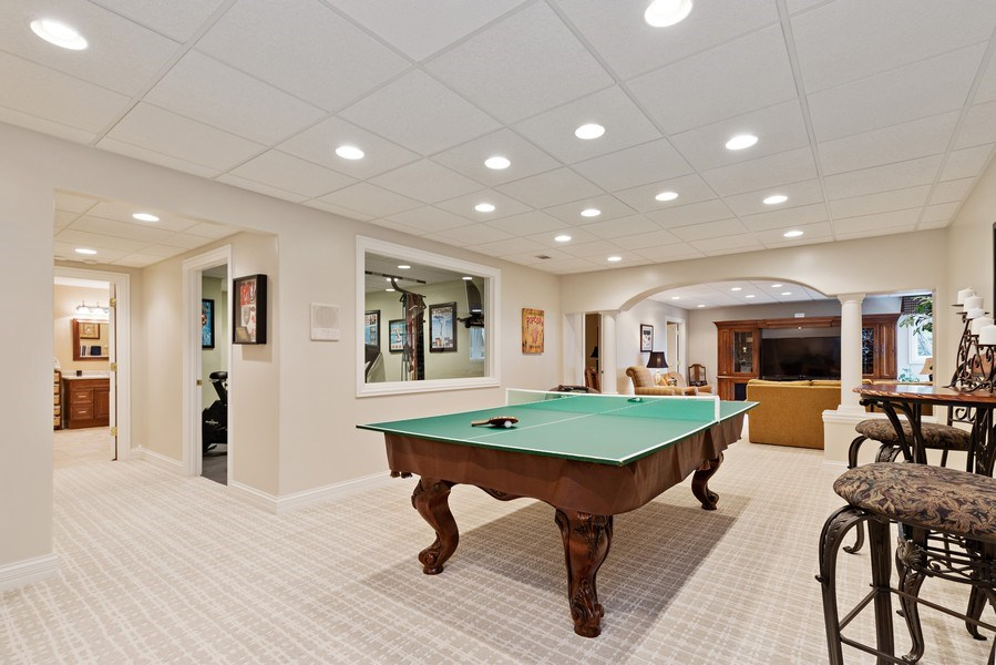 Real Estate Photography - 29040 N. Spoon Court, Mundelein, IL, 60060 - Game room in basement