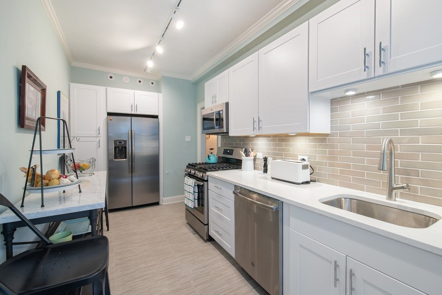Real Estate Photography - 3530 N. Lake Shore Drive, Unit 11B, Chicago, IL, 60657 - Kitchen with 2019 appliances