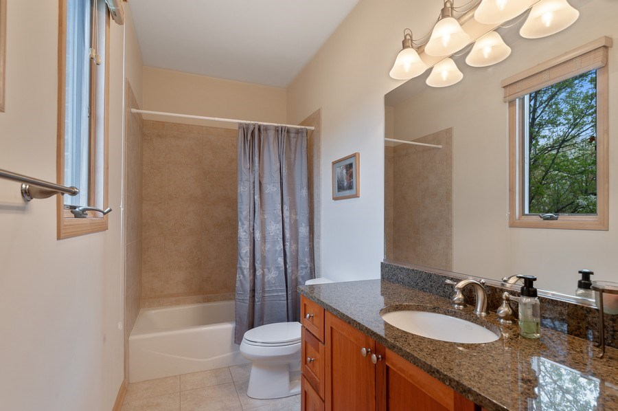 Real Estate Photography - 39716 Orchard Bluff Lane, Wadsworth, IL, 60083 - 1st Floor Bathroom Ensuite With Guest Bedroom