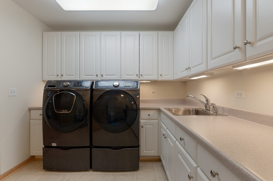 Real Estate Photography - 39716 Orchard Bluff Lane, Wadsworth, IL, 60083 - 2nd Floor Laundry Room