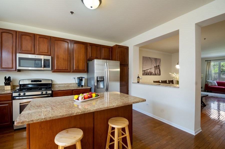 Real Estate Photography - 4655 N. Laporte Avenue, Chicago, IL, 60630 - Kitchen / Living Room