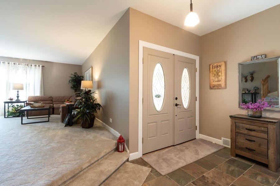 Real Estate Photography - 4218 Wilson Avenue, Rolling Meadows, IL, 60008 - Foyer/Living Room
