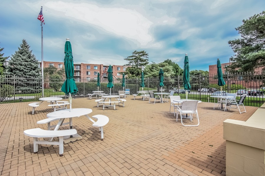 Real Estate Photography - 1505 E. Central Road, Unit 106A, Arlington Heights, IL, 60005 - Swimming Pool Patio Area