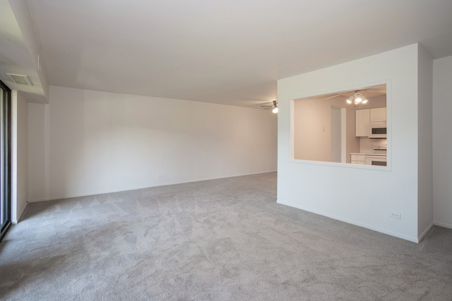 Real Estate Photography - 1505 E. Central Road, Unit 106A, Arlington Heights, IL, 60005 - Living Room / Dining Room