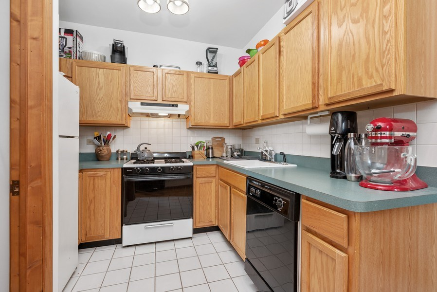 Real Estate Photography - 1829 West School St, Chicago, IL, 60657 - Kitchen
