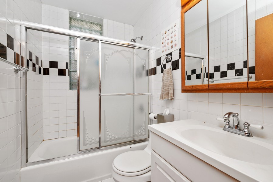 Real Estate Photography - 1829 West School St, Chicago, IL, 60657 - 2nd Bathroom