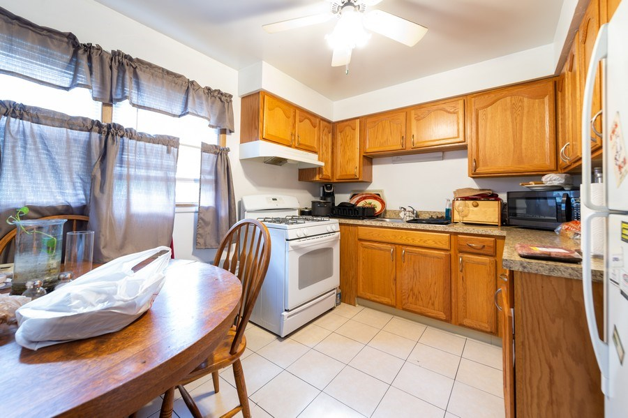 Real Estate Photography - 5908 Butterfield Rd, Berkeley, IL, 60163 - Kitchen