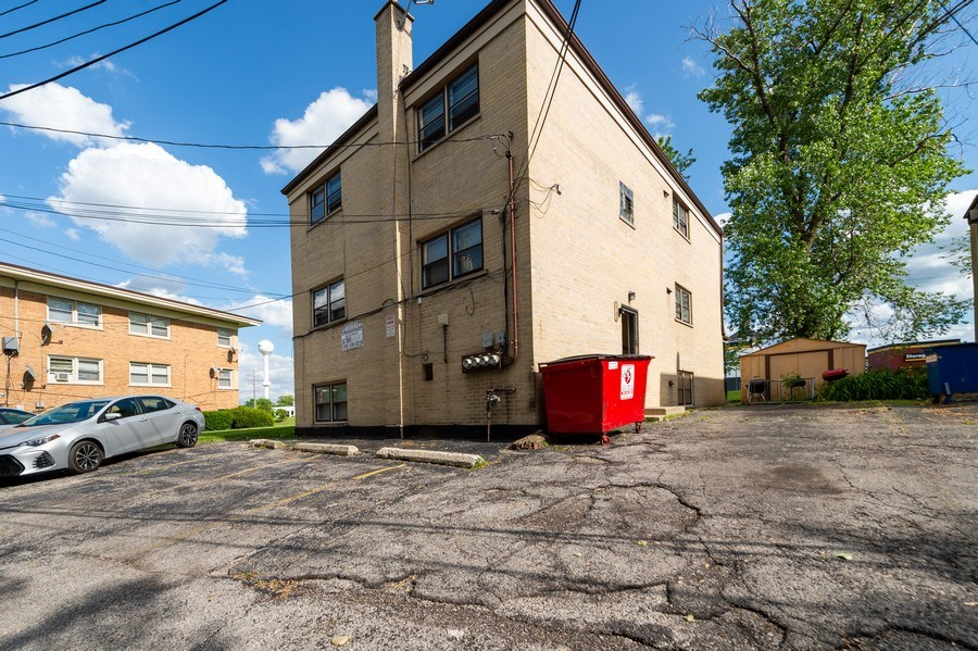Real Estate Photography - 5908 Butterfield Rd, Berkeley, IL, 60163 - Parking Area