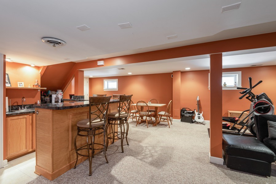 Real Estate Photography - 5457 N. NORDICA Avenue, Chicago, IL, 60656 - Basement Rec Room View 1