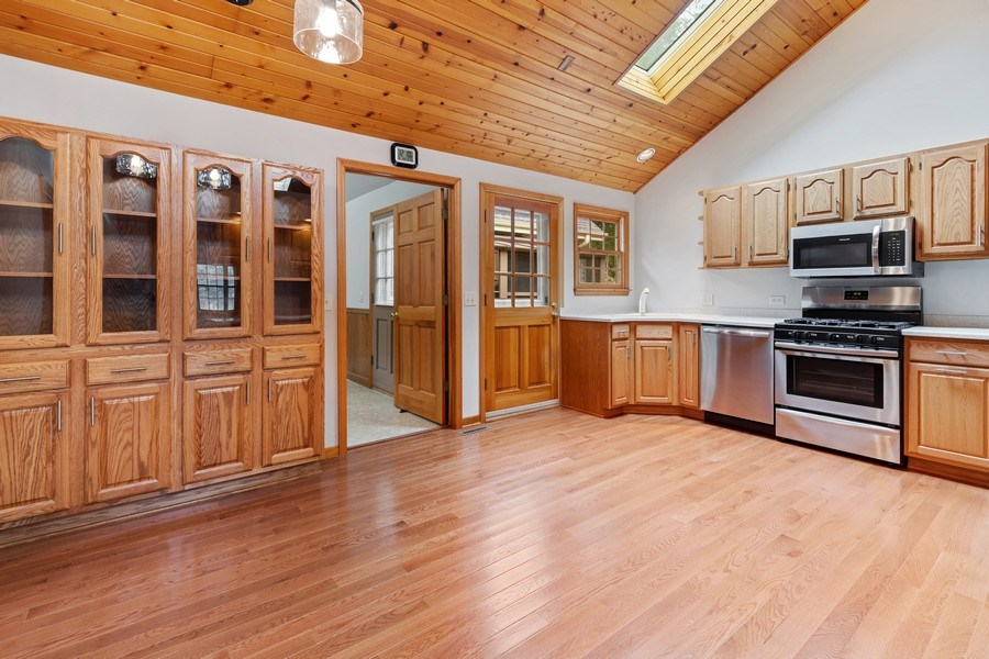 Real Estate Photography - 34925 North James Ave, Ingleside, IL, 60041 - Kitchen and Eating Area